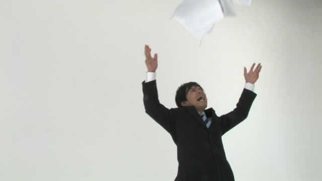 businessman throwing paper - suit stock videos & royalty-free footage