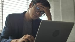 Businessman Tired of work Looking on Laptop
