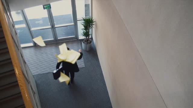 stockvideo's en b-roll-footage met ws ha businessman tossing up paperwork and walking out door / bellevue, washington, usa - ontslaan