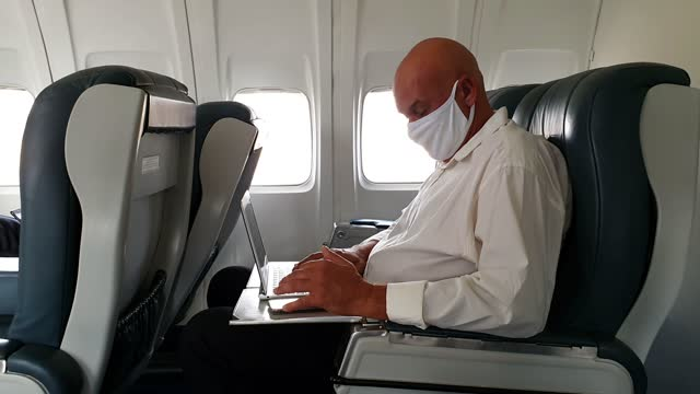 businessman traveling in first class. - business travel stock videos & royalty-free footage
