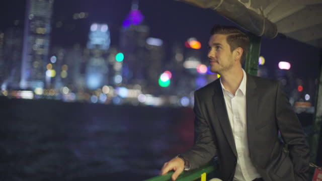 MS TS businessman travelling on a boat at night