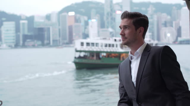 stockvideo's en b-roll-footage met ms businessman travelling on the star ferry in hong kong - star ferry