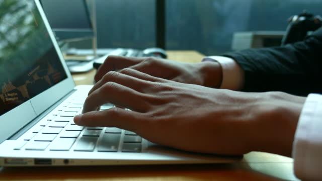 businessman typing on laptop keyboard, dolly shot - shift key stock videos & royalty-free footage