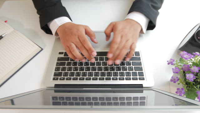 Businessman typing on laptop keyboard , Top view
