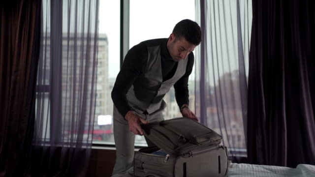 businessman unpacking his suitcase - unpacking stock videos & royalty-free footage