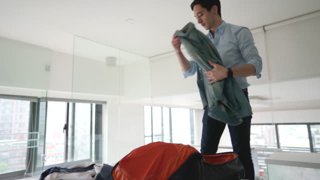 businessman unpacking luggage in a hotel room - unpacking stock videos & royalty-free footage