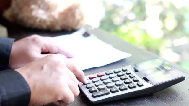 businessman using a calculator - subtraction stock videos & royalty-free footage