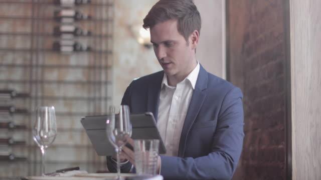 Businessman using a digital tablet in a restaurant