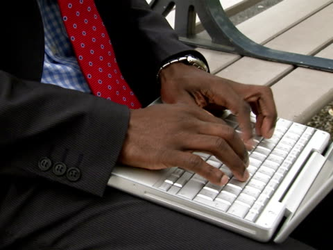 a businessman using a laptop stockholm sweden. - only mid adult men stock videos & royalty-free footage