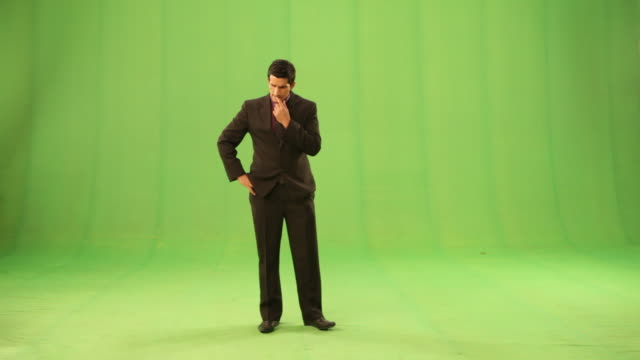 businessman using a mobile phone for direction  - suit stock-videos und b-roll-filmmaterial