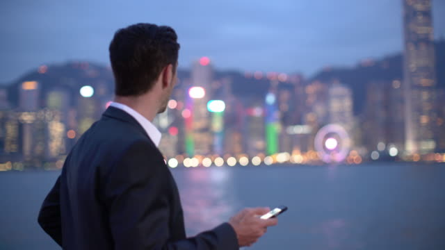 MS businessman using a mobile phone in Hong Kong