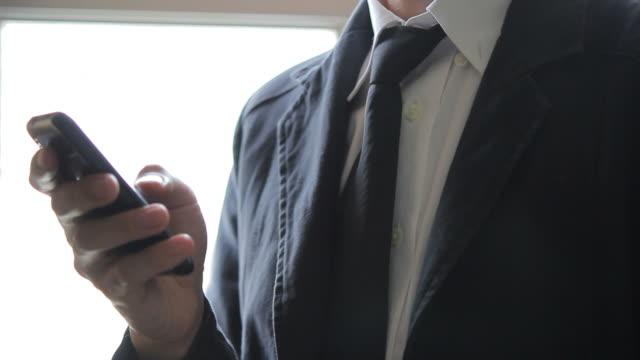HD : Businessman using a smart phone