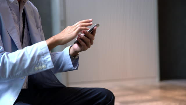 DS Businessman using a smart phone