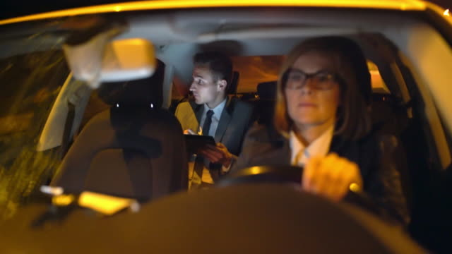 ws businessman using a tablet in the back seat of a limousine at night - limousine stock videos & royalty-free footage
