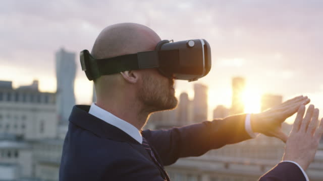 businessman using a virtual reality glasses on the roof - cyberspace stock videos & royalty-free footage