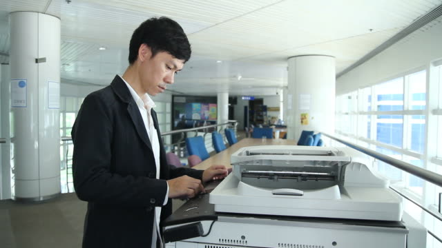 businessman using an office printer - printer occupation stock videos and b-roll footage