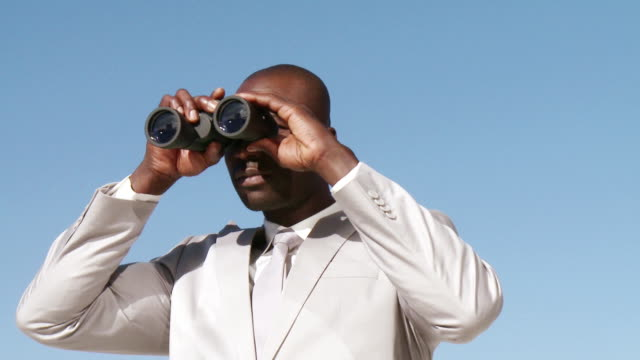 cu businessman using binoculars, cape town, south africa - binoculars stock videos & royalty-free footage