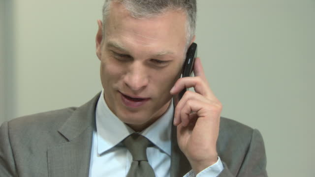 businessman using cellphone and laptop - only mature men stock videos & royalty-free footage