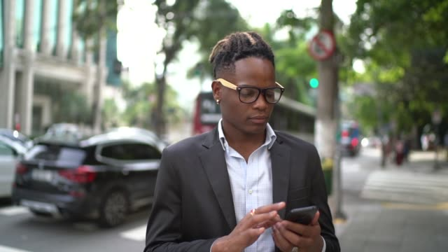 businessman using cellphone in the street - concentration stock videos & royalty-free footage