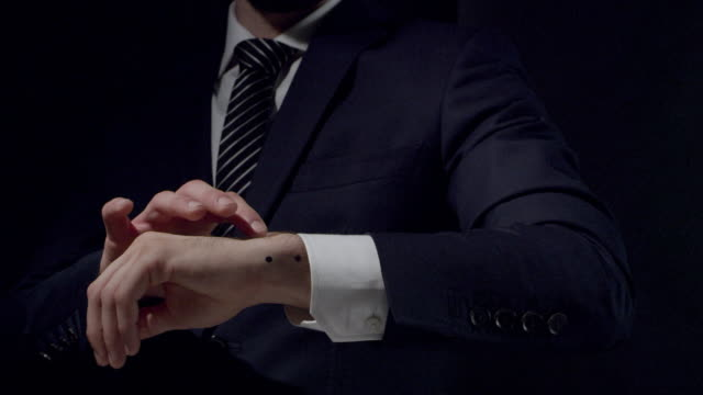 businessman using cg smart watch - clean space for holographic effect. camera trackers on wrist - wrist stock videos & royalty-free footage