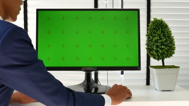 businessman using computer green screen in the office - computer monitor mockup stock videos & royalty-free footage