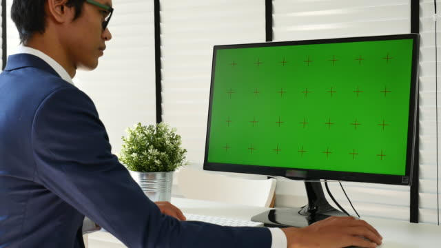 businessman using computer green screen - desk stock videos and b-roll footage