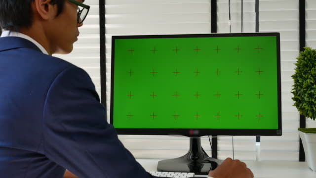 businessman using computer with green screen, chroma key - over the shoulder view stock videos & royalty-free footage