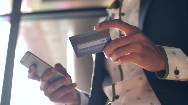 businessman using credit card for mobile shopping - home shopping stock videos & royalty-free footage