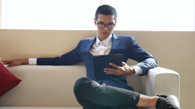 Businessman Using Digital Tablet At Home