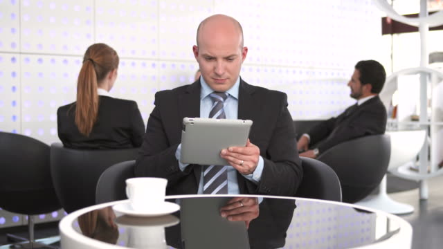 hd dolly: businessman using digital tablet at the café - short phrase stock videos and b-roll footage