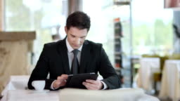 HD DOLLY: Businessman Using Digital Tablet At The Café