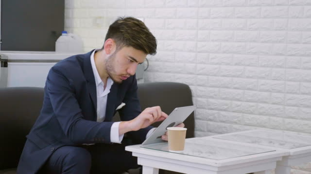 businessman using digital tablet at the café - coffee drink stock videos & royalty-free footage