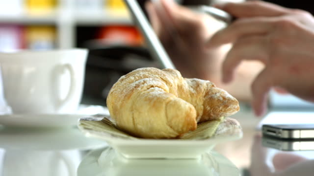 hd dolly: businessman using digital tablet during breakfast - croissant stock videos & royalty-free footage