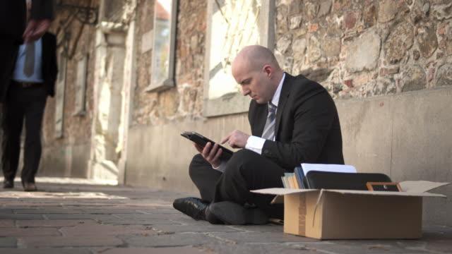 HD DOLLY: Businessman Using Digital Tablet On Street