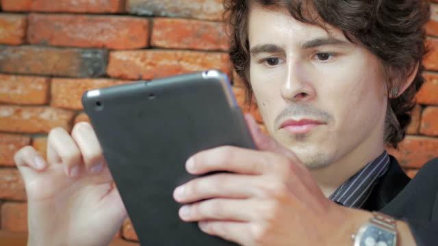 businessman using digital tablet - människofinger bildbanksvideor och videomaterial från bakom kulisserna