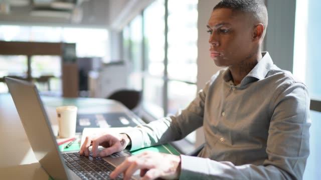 businessman using laptop at work - university student stock videos & royalty-free footage