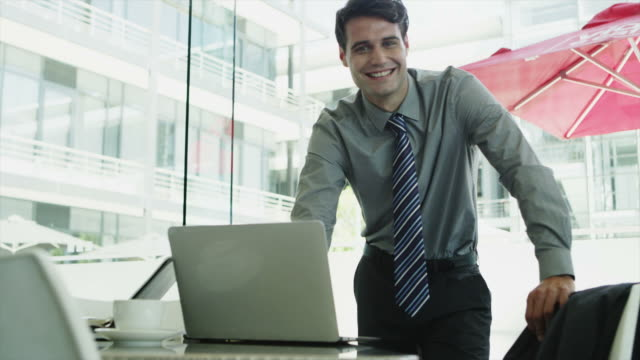 MS DS of businessman using laptop on office