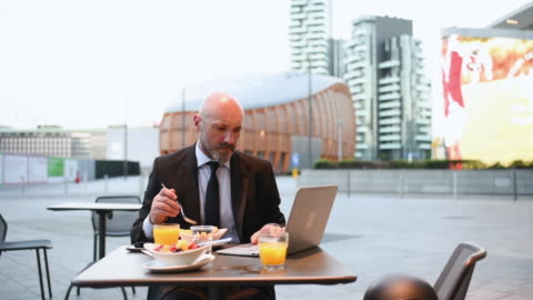 businessman using laptop - completely bald stock videos & royalty-free footage
