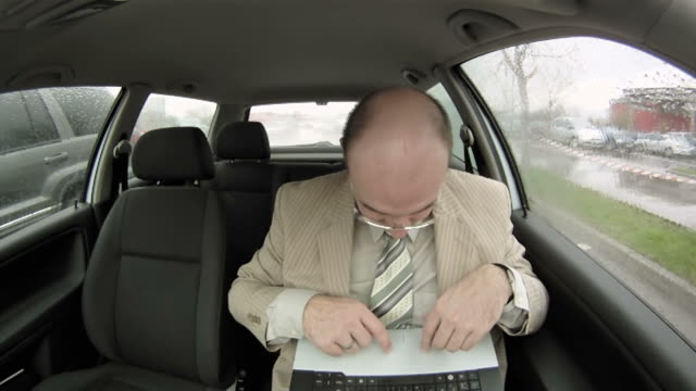 HD: Businessman Using Laptop