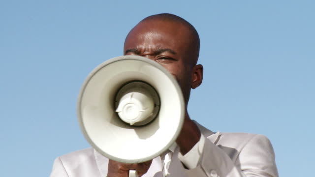 cu businessman using megaphone, cape town, south africa - megaphone stock videos & royalty-free footage