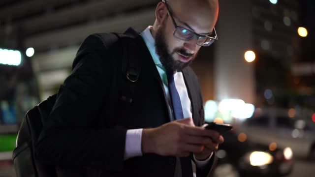 businessman using mobile at night - busy stock videos & royalty-free footage