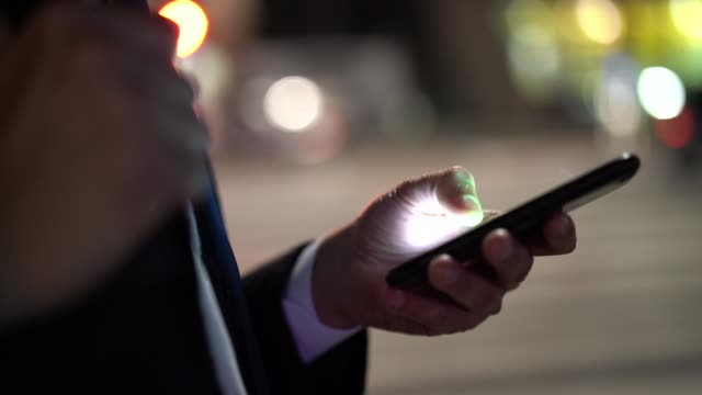 businessman using mobile at night - message stock videos & royalty-free footage
