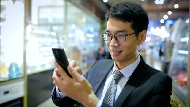 businessman using mobile phone - portability stock videos and b-roll footage