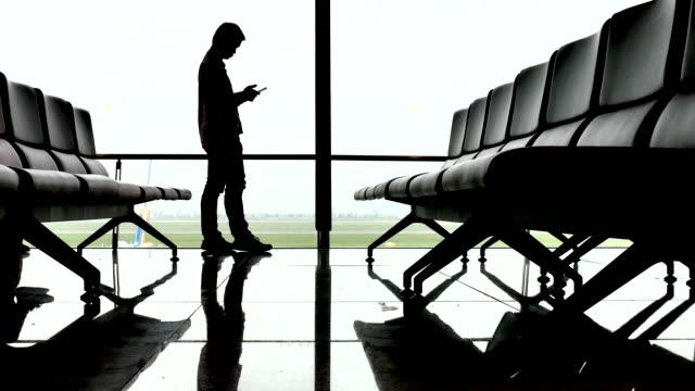 Businessman using phone at Terminal airport