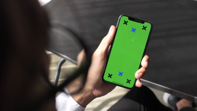 Businessman Using Phone with green screen in office, Close-up