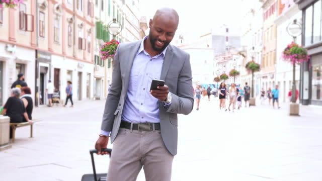businessman using smart phone - 4k video - business travel stock videos & royalty-free footage