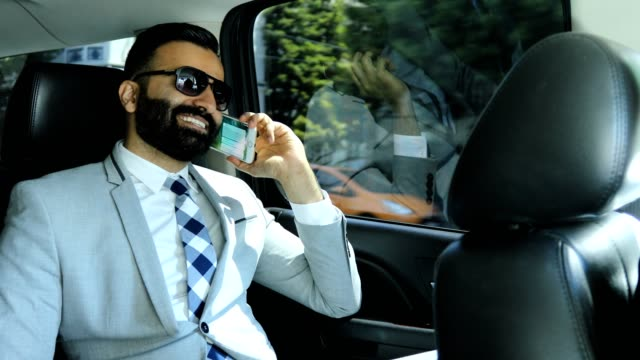 businessman using smart phone in a limousine - stereotypically upper class stock videos & royalty-free footage