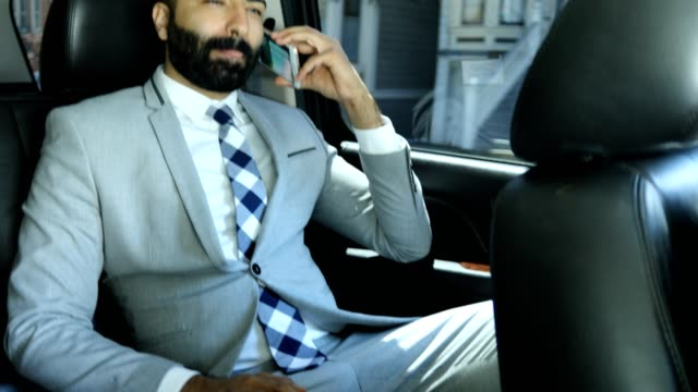 businessman using smart phone in a limousine - prestige car stock videos & royalty-free footage