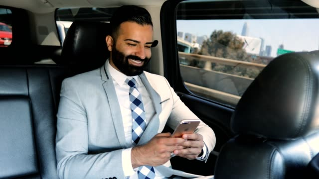 businessman using smart phone in a limousine - middle eastern ethnicity stock videos and b-roll footage