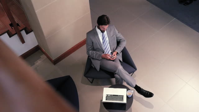 businessman using smart phone - chair stock videos & royalty-free footage